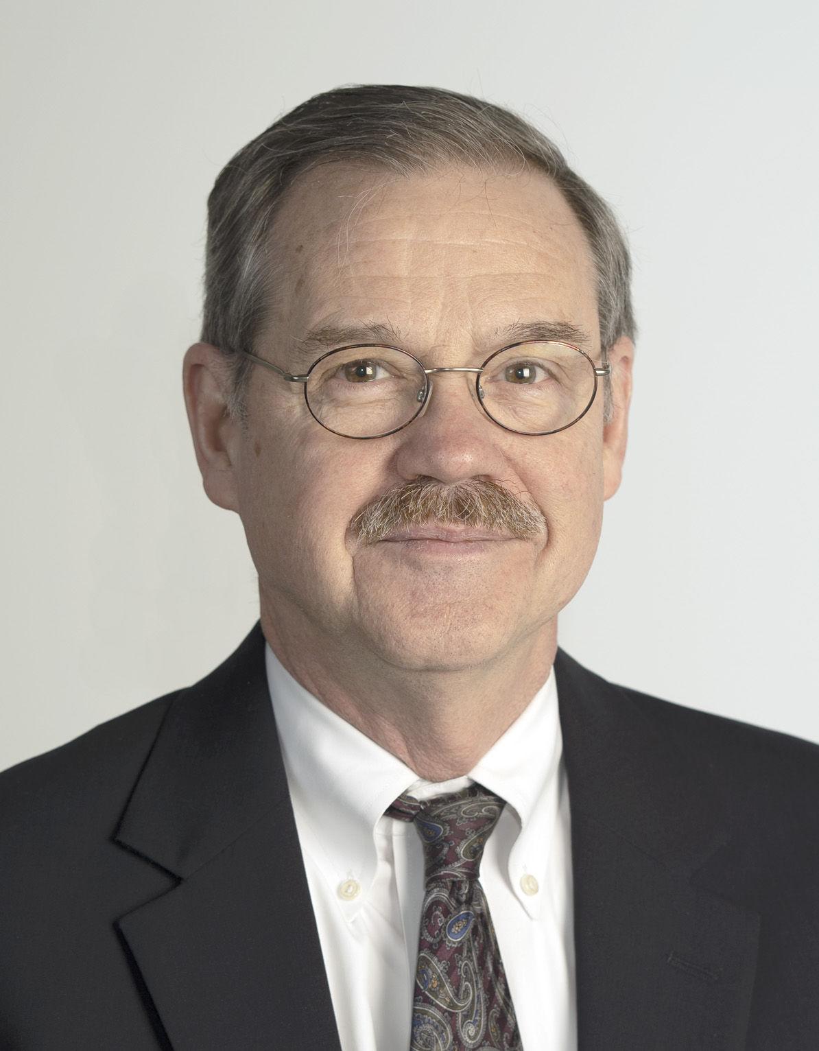 Headshot image for Dr. Robert J. Plunkett